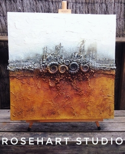Mixed media canvas with fossil ammonite mould and textures by Anna Howlett