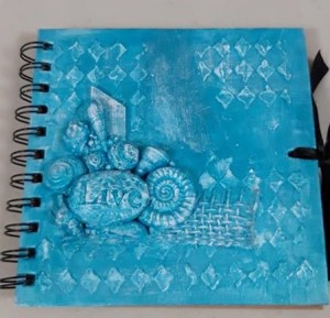 Crafting for children with Powertex. Blue journal cover by Jill Cullum