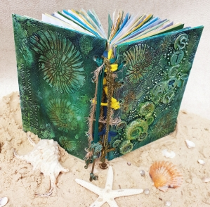 Ocean inspired journal with fossil ammonites from Stone Art Clay by Shell North