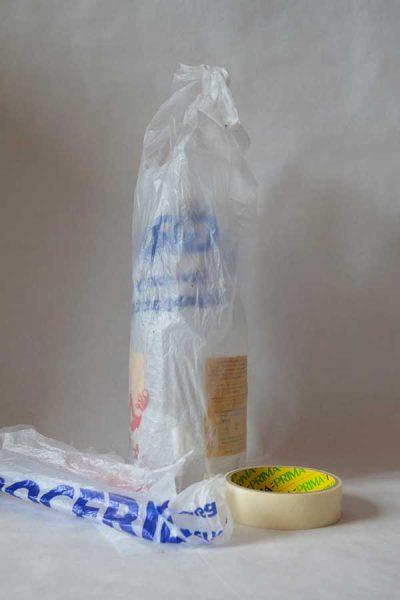 Wrap the bottle in plastic