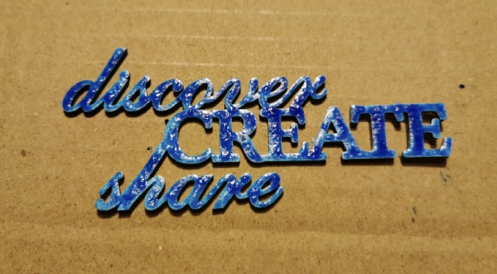 Paint chipboard words from the Secret Art Box with acrylic inks