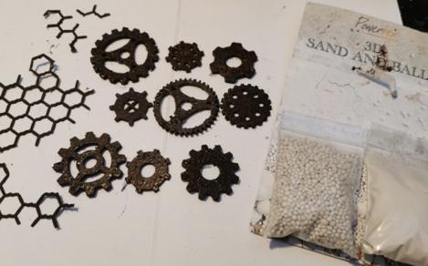 Paint cogs from the Secret Art Box with Bronze Powertex