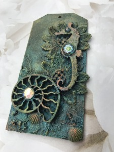 Mixed media tag with Seahorse and lace by Tracey Evans