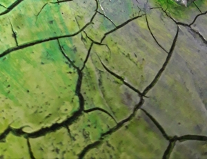 Add green colours to the cracked areas of the planet